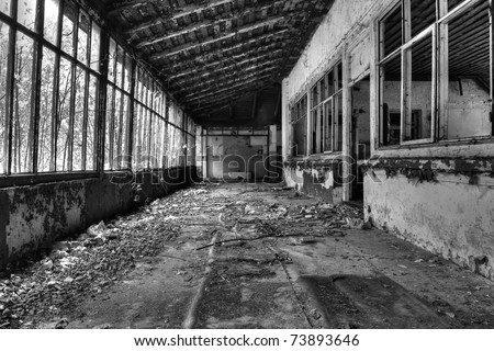 broken windows at the old house, black and white - stock photo