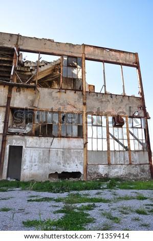 Broken windows in an abandoned building - stock photo