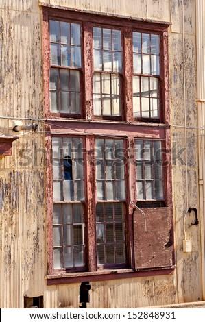 Broken Windows of Abandoned Industrial Building - stock photo
