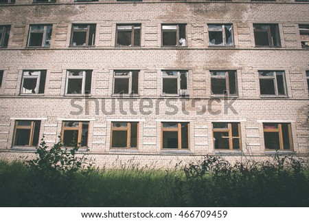 broken windows with smashed glass and dust - vintage film effect