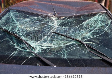 Broken Windshield after car crash - stock photo