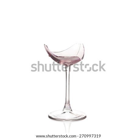 Broken wineglasses isolated on white - stock photo