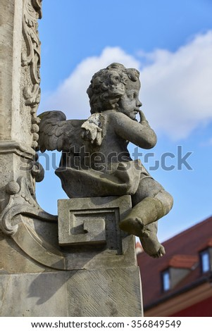 Broken wing angel statue with blue sky - stock photo
