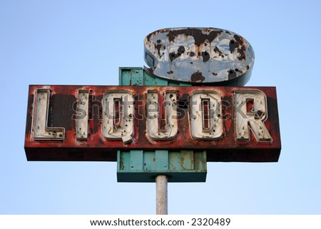 "broken yet beautiful old rusty ""liquor store"" neon sign - stock photo"
