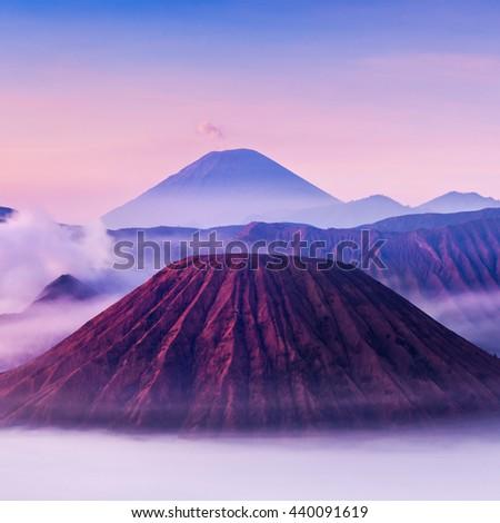 Bromo, Batok and Semeru volcanoes at sunrise, Java island, Indonesia, soft focus - stock photo