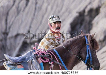 BROMO, INDONESIA - JULY 23, 2016: Unidentified horse riders with his horse near Mt.Bromo in early morning.