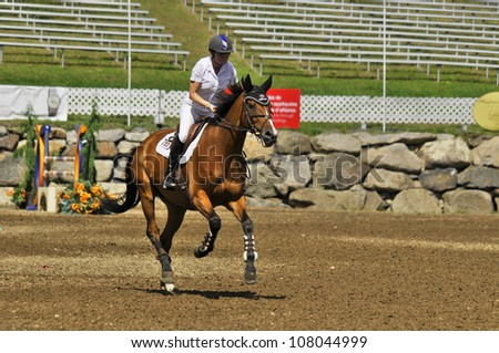 BROMONT-CANADA JULY 19: Unknown rider on a horse during 2012, INTERNATIONAL BROMONT on July 19, 2012 At the Equestrian 1976 Montreal Olympic Park. - stock photo
