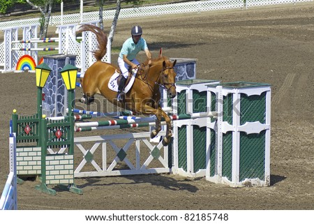 BROMONT-CANADA JULY 23: Unknown rider on a horse during 2011, INTERNATIONAL BROMONT on July 23 2009 At the Equestrian 1976 Montreal Olympic Park. - stock photo
