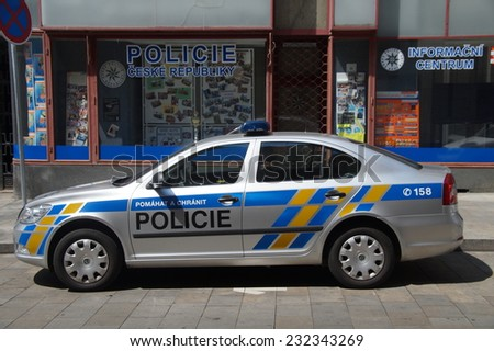 BRON, MORAVIE, CZECH REPUBLIC - JULY 20, 2014: Municipal police car, Skoda Octavia, parked on a city street in front of a local police station. Nobody in vehicle. - stock photo
