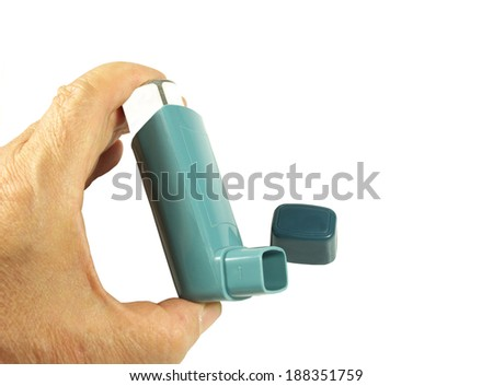 Bronchodilator inhaler using in Asthma patient on white background. - stock photo