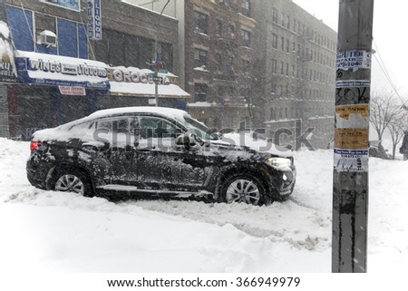 BRONX, NEW YORK - JANUARY 23: Auto stuck on Anderson Avenue during snow storm Jonas.  Taken January 23, 2016, in the Bronx,  New York. - stock photo