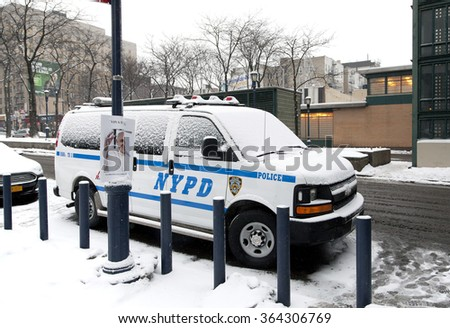 BRONX, NEW YORK, USA - FEBRUARY 19: Police vehicle parked with snow on it.  Taken February 19, 2015 in the Bronx,  New York. - stock photo