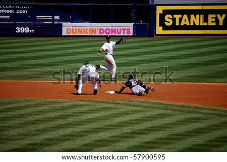 BRONX, NY - AUGUST 30 - Alexei Ramirez of the White Sox steals second base against the Yankees as the throw comes up short to Robinson Cano in a game at Yankee Stadium August 30, 2009 in Bronx, NY