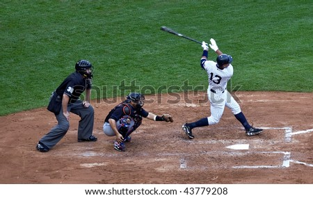 BRONX, NY - JUNE 13: Alex Rodriguez hits his 562nd career home run vs. the NY Mets on June 13, 2009 in Bronx, NY. Mets won the game 6-2 and the Yankees became World Series Champions. - stock photo