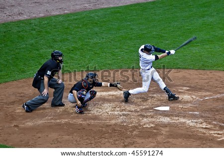 BRONX, NY - JUNE 13: Derek Jeter, the Yankee hit leader. Head down, full extension - a classic swing in a game vs. the Mets on June 13, 2009 in Bronx, NY. The Yankees became World Series Champions. - stock photo
