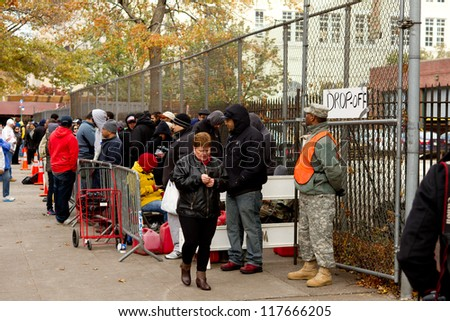 BRONX, NY - NOVEMBER 3: Hurricane Sandy causes gas shortage in Bronx  free gas relief program at Bronx Armory in the Bronx NY, U.S., on Saturday, November 3, 2012. - stock photo