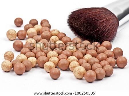 Bronze beads blush with makeup brush isolated on white  - stock photo
