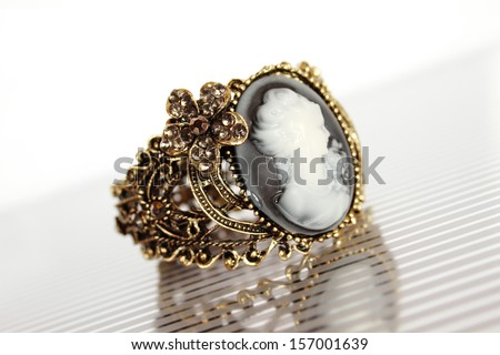 Bronze bracelet carved with the image of a girl silhouette - stock photo