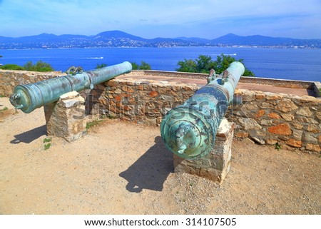 Bronze canons defending old fortress in Saint Tropez, French Riviera, France - stock photo