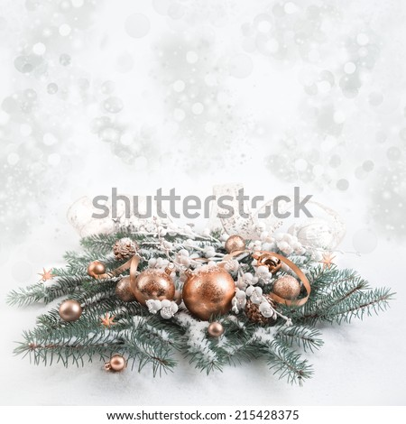Bronze Christmas decorations on neutral background, text space