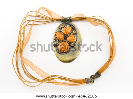 bronze decoration on an orange ribbon with stones