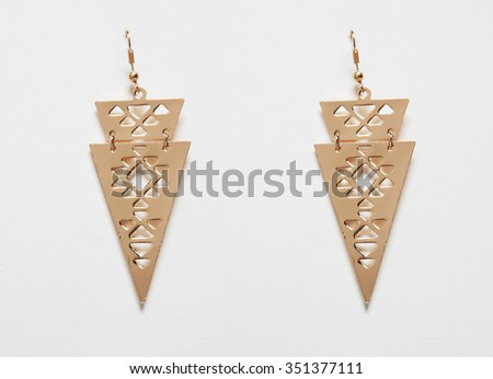 bronze earrings isolated on white background - stock photo