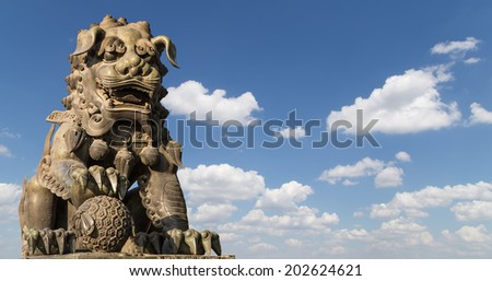 Bronze Guardian Lion Statue in Yonghe Temple (Lama Temple) in Beijing, China