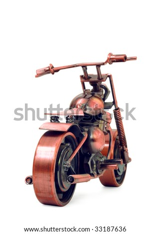 Bronze handmade model of motorcycle. Rear view. Isolated on white - stock photo