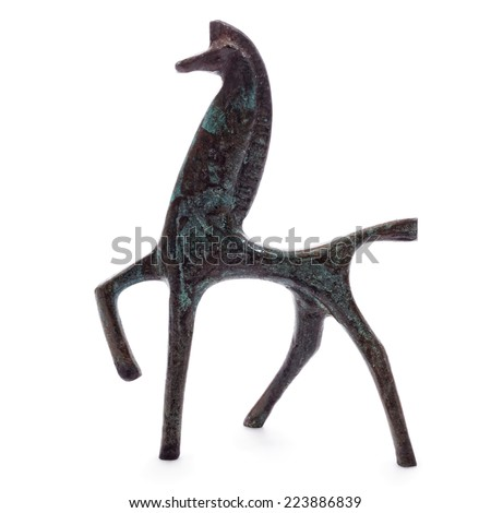 Bronze horse in an alert position, the body with geometrics, the front hoof raised. - stock photo