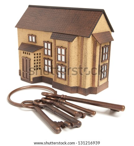 Bronze key and house model  isolated on white background - stock photo
