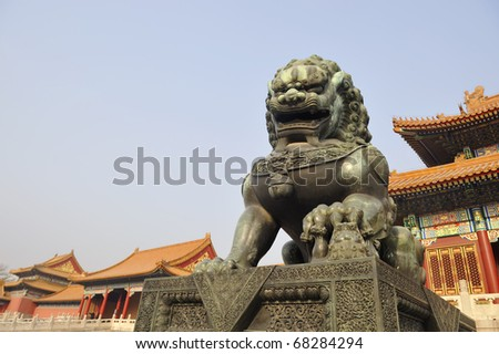 Bronze lion at entrance of The Forbidden City in Beijing, China.