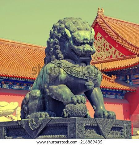 Bronze lion - detail in the Forbidden City in Beijing, China, instagram effect - stock photo