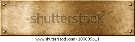 Bronze metal plate with four screw bolts isolated - stock photo