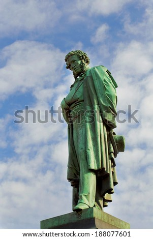 Bronze monument to Pushkin in Moscow on a pedestal - stock photo