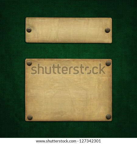 Bronze nameplate on green background