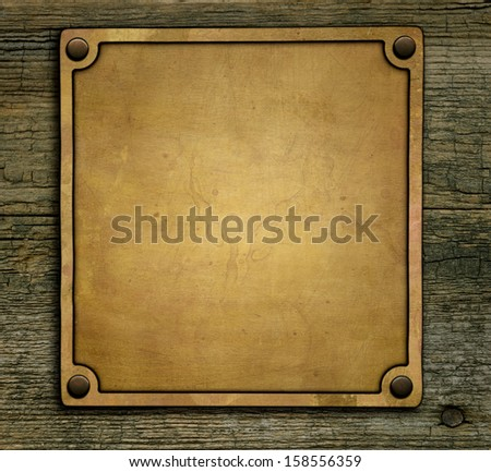 Bronze nameplate on green background - stock photo