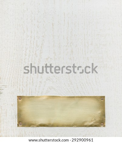 Bronze plate on white wood