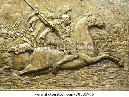 Bronze relief depicting Alexander the Great and his army in battle. - stock photo