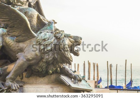Bronze roaring winged lion, Venice city symbol, Detail of The Queen of Adriatic Plaza Statue - stock photo