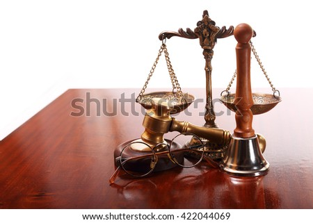 Bronze scales, gave,round-framed glassesl and bell on the judge's desk