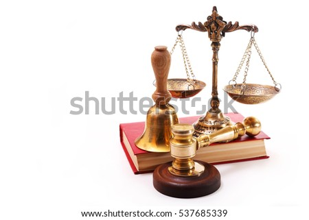 Bronze scales, gavel, a bell and a red book on a white background