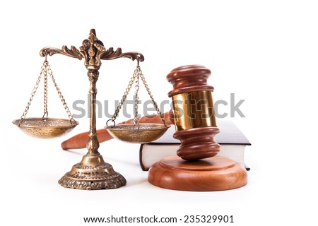 Bronze scales, gavel and book on white background - stock photo