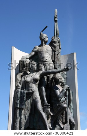 Bronze statue depicting the Maori in Wellington Harbourfront. North Island, New Zealand. - stock photo