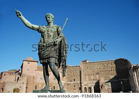 bronze statue of an Caesar in front of the Trajan Forum in Rome, Italy