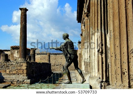 Bronze statue of Apollo in a ruined temple at the ancient Roman city of Pompeii, which was destroyed and buried by ash during the eruption of Mount Vesuvius in 79 AD. - stock photo