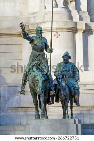 Bronze statue of Don Quixote and Sancho Panza in Plaza de Espana, Madrid - stock photo