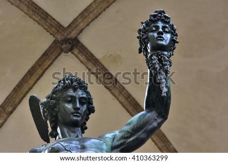 Bronze statue of Perseus holding the head of Medusa in Piazza della Signoria square (Florence), made by famous artist Benvenuto Cellini in 1545 - stock photo