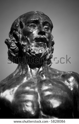 """Bronze Statue of """"Saint John the Baptist Preaching"""" by sculptor Auguste Rodin in black and white. - stock photo"""