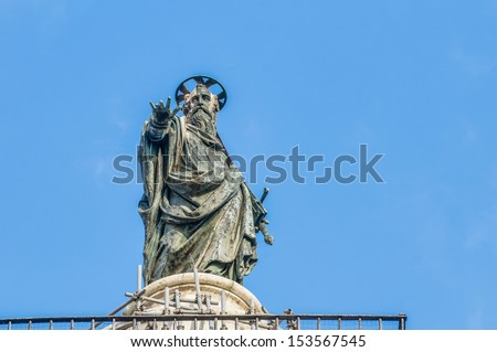 Bronze statue of Saint Paul that crowns the marble Column of Marcus Aurelius which has stood on Piazza Colonna since 193 CE in Rome, Italy. - stock photo
