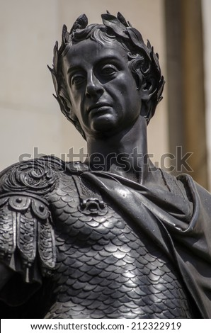 Bronze statue of the late King James II wearing the uniform of a Roman Emperor in Trafalgar Square, London.  Believed to be sculpted by Grinling Gibbons and on public display in London since 1686. - stock photo